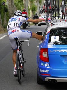 FDJ-Bigmat rider Anthony Roux of France receives medical assistance from his team as he cycles during the stage of the Tour de France cycling race between Saint-Paul-Trois-Chateaux and Cap d'Agde. BOGDAN CRISTEL/REUTERS How cool! Pro Cycling, Cycling Bikes, Bicycle Race, Going To The Gym, Bike Life, Triathlon, Racing, Tours, Instagram