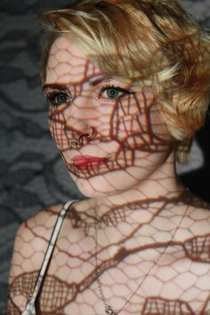 IMG_8943 - Part One: For this photo, I wished to cover the model as much as possible with the lace to give her a caged feel, without loosing her features completely. I placed the projector slightly to the left of where I was, to fill her face with light and lace. However, the lace did cover her mouth, which could have been improved by moving it on the projector, but her eye does gleam and pop in the light, which is a positive aspect.