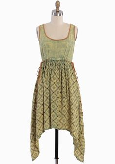Mariah Asymmetrical Dress By Scrapbook 89.99 at shopruche.com. We adore the playful air of this casually chic green and yellow dress complemented with a watercolor wash and a whimsical asymmetrical hem. Designed by Scrapbook, the soft cotton style is completed with cheerful embroidered accents, an...