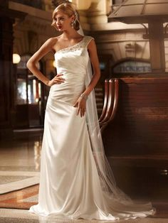 Endlessly glamorous, incredibly stylish, progressive and versatile - you are red carpet ready in every way for your vintage affair! Style SWG494. #davidsbridal #greatgatsby #gatsbywedding