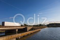 Qdiz Stock Photos | Truck on the bridge,  #asphalt #automobile #autotruck #bridge #business #car #cargo #commercial #delivering #delivery #driving #fast #freight #highway #industry #lake #land #lane #logistic #lorry #merchandise #motion #motor #motorway #moving #road #semi #semi-truck #shipping #speed #thoroughfare #trailer #transport #transportation #truck #trucking #vehicle #wagon