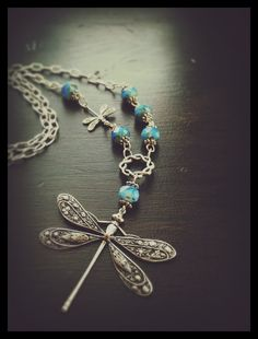 Dragonfly necklace with baby dragonfly adorned with Forget Me Not Opal colored fire polished Czech Picasso beads on Etsy, $26.00