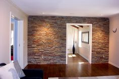 This idea is already in the queue for one of our family room walls. This idea is alr Faux Stone Walls, Stone Accent Walls, Faux Brick, Spare Bedroom Decor, Master Bedroom, Family Room Walls, Brick Interior, Fixer Upper, Home Projects