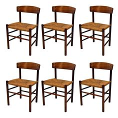 Set of Six Walnut Dining Chairs by Borge Mogensen, Denmark | From a unique collection of antique and modern dining room chairs at https://www.1stdibs.com/furniture/seating/dining-room-chairs/
