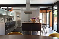Ikea-like kitchen in post-and-beam home with clerestory windows. From: PRJ - La Canada Midcentury — Jamie Bush + Co.