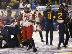Oklahoma's Bobby Evans (71) celebrates after an OU touchdown during a college football game between the University of Oklahoma Sooners (OU) and and the West Virginia University Mountaineers (WVU) on Mountaineer Field at Milan Puskar Stadium in Morgantown, W. Va., Saturday, Nov. 19, 2016. Photo by Bryan Terry, The Oklahoman