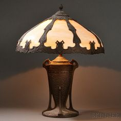 Arts & Crafts Slag Glass Table Lamp. Art glass and patinated metal. United States, early 20th century.