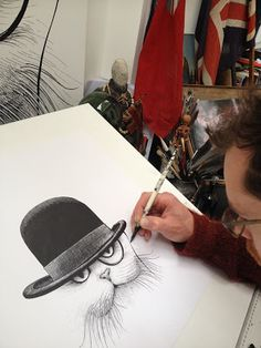 Rory Dobner at work on his Cheshire Cat Cushion
