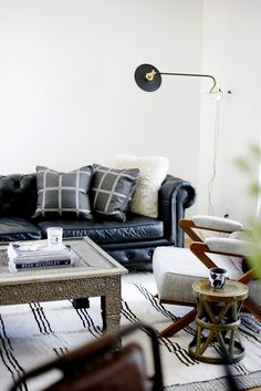 This living room designed by Brian Paquette is full of masculinity with it's industrial elements and leather couch