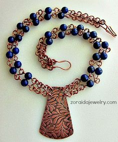 Newly redone necklace with etched pendant