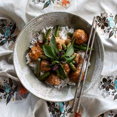 """RED CURRY PORK MEATBALLS WITH GREEN BEANS. Substituting meatballs for slower cooked cuts of meat makes for perfect 30 minute cooking without sacrificing flavours. This recipe combines free range pork mince balls with green beans and Thai basil in a rich red coconut sauce. Served with steamed long grain rice, this is a """"must cook"""" dish. 30 Minutes. Free Range."""