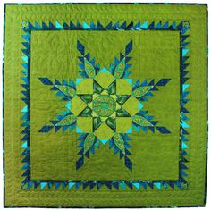 "My First Feathered Star, 35 x 35"", by Suzanne Arnholter. 2013 Hoffman Challenge - Pieced Curators Choice"
