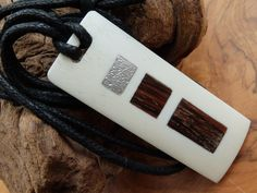 Hand crafted Bone pendant with hardwood and sterling silver inlay. £20.00