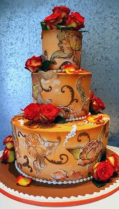 Three tier wedding cake hand painted and airbrushed in autumn theme earthy colours and decorations. Embellished with burnt orange/red fresh roses. From www.rosebudcakes.com                      #wedding #cake #birthday