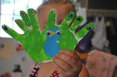 Handprint peacock craft. Two hands, one tail. This peacock has it going on.    #kidscrafts #kids #handprints