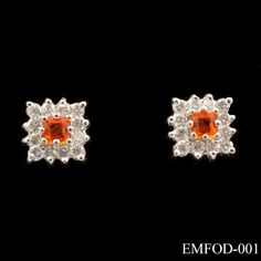 These unusual earrings comprise of a single, square cut mexican fire opal as the centre stone, surrounded by a round cut diamond border (.67ct total - G/VS). Shared claw set in 18ct white gold with 18ct yellow gold stems, these pretty earrings are sure to be noticed. £595