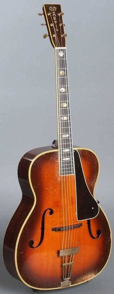 Martin F-9 (1936) The F-9 was Martins top-of-the-line archtop and the most expensive guitar that they made in the 1930s (even more than a D-45) sunburst carved spruce top Brazilian rosewood sides and back 14-fret mahogany neck 20-fret ebony fingerboard with abalone hexagon inlays adjustable ebony bridge hinged tailpiece --- https://www.pinterest.com/lardyfatboy/