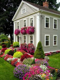 What beautiful yard work & gardening that has been done at this house.  I love it!