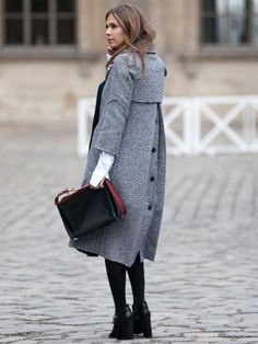 Coat with an unexpected button design and shorter sleeves offer a twist to a classic wardrobe staple.