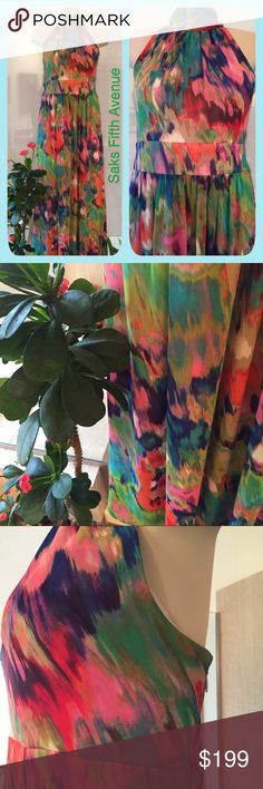 "SAKS FIFTH AVENUE Dressy Maxi Halter Dress NWOT Looks like a vibrant watercolor painting. Could be worn for Prom or other dressed up occasion...Wedding, cruise wear, etc. I purchased for a wedding and wore something else instead. Flowy Chiffon type material, fully lined with a side zipper. Padded top so a bra is not necessary. 54"" from top of shoulder to hem. From armpit to armpit 20"". But has some give with the gathered band in the back. Just stunning  Saks Fifth Avenue Dresses Maxi"