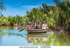 HOI AN, VIETNAM - MARCH 19, 2017: Tourists visit water coconut forest in Hoi An