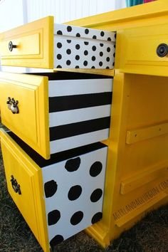 When repainting, why stop with the outside of a unit?!! Fabulously fun monochrome dots and stripes painted on sides of drawers bring a real zing to this upcycled chest of dest.