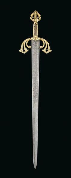 A GOLD-DAMASCENED SWORD AFTER 'LA TIZONA' OF EL CID. ATTRIBUTABLE TO THE ZULOAGA WORKSHOP, TOLEDO, SPAIN, LATE 19TH CENTURY.