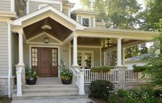 Large porch with welcoming entry - very traditional and quite beautiful. Design inspiration image.