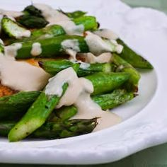 I love this Chicken and Quickly Roasted Asparagus served with Tahini Sauce. This recipe uses a small amount of flour to coat the chicken, but for lower-carb or gluten-free you could easily skip the flour. [from KalynsKitchen.com]