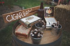 Cigar bar w/ framed pic, in honor of Papa. Rustic cigar bar. Use galvanized steel buckets for cigars and matches. Decorate with a few cigar boxes, add a framed sign, maybe a candle or a living green centerpiece. {www.artisansbloom.com}