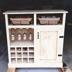 """to replace where my wine rack is. Extra storage for glasses, baskets for """"junk"""""""
