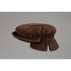 Cap, 1500-1550-EXCERPT: Knitted or felted caps were designed to be warm and waterproof. Some protected the neck, some had ear flaps, and many were trimmed with ribbons to imitate expensive silk versions. Wealthy Londoners would have worn European fashionable bonnets or caps of silk velvet decorated with ostrich feathers, aglets (jewelled pins) and brooches. Wool absorbs colour easily, so many caps were dyed in strong colours, such as red and black, which were fashionable at the time.