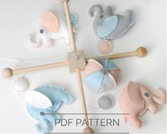 Make your own Baby Elephant Mobile with this easy to follow pattern and instructions. You can make your mobile with any color felt to match your nursery.  The PDF download includes:  *Full size printable pattern pieces to make a baby mobile *Step by step instructions *24 color photographs showing each step *Diagram showing whip stitch and running stitches *List of all the supplies you will need *Instructions for the wood mobile frame are included.  This baby elephant mobile pattern is a…