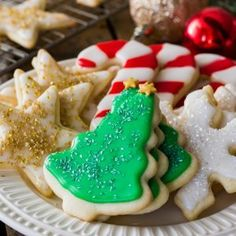 This is the BEST SUGAR COOKIE RECIPE with an easy sugar cookie frosting! The perfect Christmas cookie, these homemade sugar cookies are easy and have a great simple icing. You've never tried a better cut-out sugar cookie! Easy Sugar Cookie Frosting, Homemade Sugar Cookies, Sugar Cookie Recipe Easy, Chocolate Frosting, Sugar Cookie Icing Recipe That Hardens, Homemade Biscuits, Food Network Sugar Cookie Recipe, Coconut Cookies, Coconut Macaroons