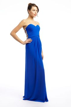 Long sweetheart neck dress with tight pleating over the bust to give a great shape. The dress has a low back with beaded crossing straps over the back. There is a ruche at the bottom of the low back giving a full drape at the back which flows when you walk.