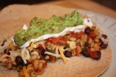 Crockpot Vegetarian Barley-Black Bean Burritos- Dinner this week...    Update: Finally tried this one! It's a winner for sure- so easy to prepare and delicious! We used corn chips to scoop rather than tortillas to wrap.