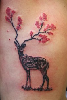 Black and Gray deer with pick flowers in the antlers on the ribs. Deer with flower antlers