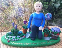 A fimo Gardener for a 70th Birthday Cake topper