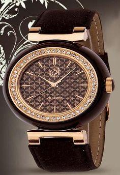 Reloj Cristian Lay con bisel de chapa de oro rosado y cristales. Escríbenos a lucyhome.ideas@gmail.com Con gusto atenderemos tu pedido