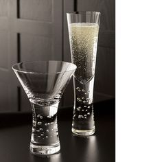 Free Shipping. Shop Verve Champagne Glass. A play of random bubbles adds verve to the exaggerated sham of this slender, ultra-modern flute. Subtly tapered shape feels great in the hand.