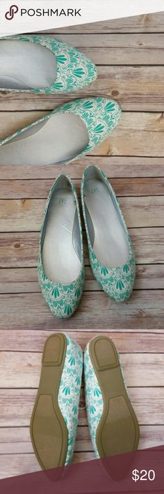 Egyptian Turquoise Pattern Flats Super cute white and turquoise patterned flats from GAP. They have never been worn and are in very good condition besides a small stain the heel as shown in the 4th image.  Size 10 and fit true to size.  If you have any questions about this item please leave a comment.  **All items from my closet come from a smoke free, cat friendly home. ** GAP Shoes Flats & Loafers