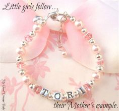Click here to see this beautiful mother/daughter bracelet set! Sure to be a big hit with moms and daughters as a gift for Mother's day, birthdays, or for any occasion. A Mother Daughter bracelet set allows mom and daughter to show their love with matching bracelets. The Tori Key To My Heart Mother Daughter Bracelet Set features: Set of two bracelets-one for mom and one for daughter with child's name on both bracelets. $99.95 (http://www.mysweetdreamsbaby.com/torimotherdaughterset.htm)