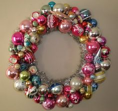 Like the bit of tinsil that rings the inside of the wreath, complimenting the vintage glass ornaments.
