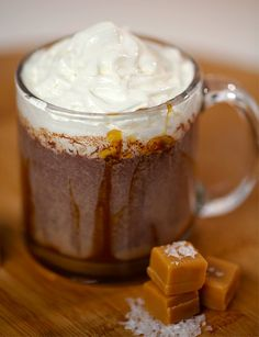 Dunkin' Donuts Salted Caramel Hot Chocolate: 3 tablespoons Trader Joe's fleur de sel caramel sauce, warmed until pourable, 1 cup milk, 2 ounces dark chocolate, Whipped cream, Pinch of sea salt
