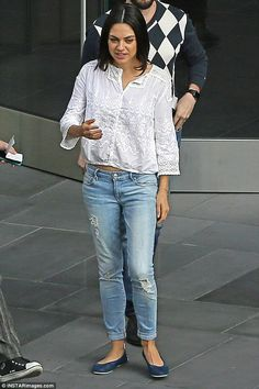Hinting: Mila Kunis bared a bit of her midriff while out in Hollywood this Friday