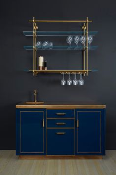 1 Bay Wall Mounted Collector's Shelving Unit with Stemware Holders + LED Lightbars : Amuneal& 1 Bay Collector& Shelving Unit in warm brass and glass with stemware holders and LED lightbars. Shown here over Amuneals& Blue Lacquer Bar with Integral sink. Glass Bar Shelves, Wall Shelves, Kitchen Cabinets Brands, Bar Cabinets For Home, Kitchen Reno, Brass Shelving, Open Shelving, Shelving Systems, Bar Sala