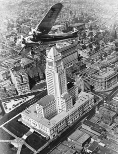 A plane flies over a then-new LA City Hall. losangelespast: A Ford Tri-Motor plane circles City Hall, Los Angeles Area, Downtown Los Angeles, Chicano, Cities, California Camping, Southern California, Vintage California, Adventures Of Superman, California History
