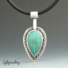 Chrysocolla Pendant, Silver Pendant, Sterling Silver, Chrysocolla, Necklace, Metalsmith Jewelry, Handmade Jewelry, Artisan Jewelry  A lovely pendant made of sterling silver and a chrysocolla cabochon set in a bezel for its focal point. The stone setting is framed with a section of sterling silver rolo chain. The pendant including the bail is approximately 1 7/8 inches long and 7/8 inches at its widest point.  The small toggle can be unscrewed from the necklace and the pendant can be...