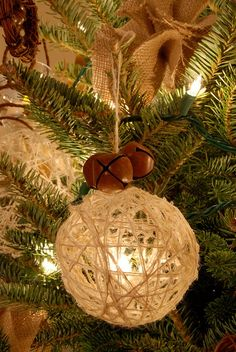 "Christmas Ornament - String dipped in glue and wrapped around a balloon. Looks great here, with the addition of rusty jingle bells (which you can age yourself-see my board, ""Christmas Crafts"") and burlap ribbon."