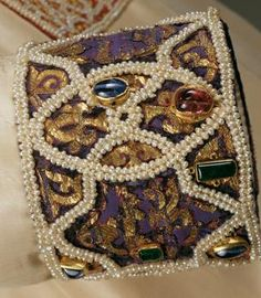 This looks to be a cuff(?) from the Palermo Alba, showing gorgeous embroidery, as well as the use of pearls and gems! Dated 1181 CE, with later additions. Kunsthistorisches Museum Wien, Weltliche Schatzkammer. Inventory number SK_WS_XIII_7